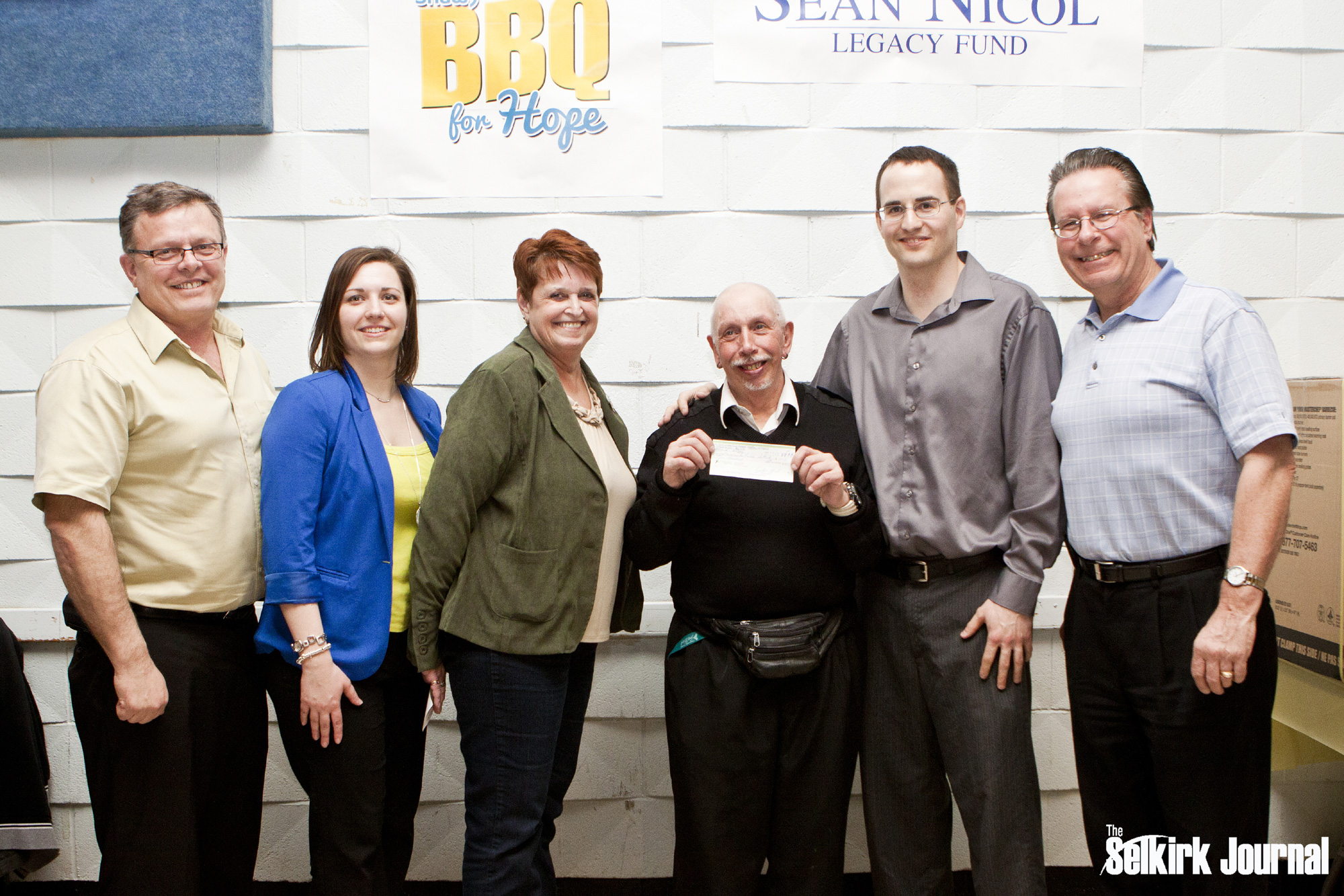 Sponsors George Hacking and Larry Johannson join SNLF committee members to present Association for Community Living Selkirk with a $100 Grant. This is the first grant ever made by the Sean Nicol Legacy Fund!