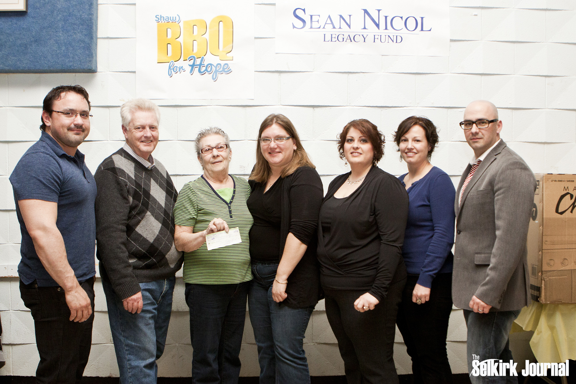 Sponsors Matt Evans and Chris Turcotte join SNLF committee members to present representatives from Our Daily Bread Soup Kitchen with a $100 Grant.