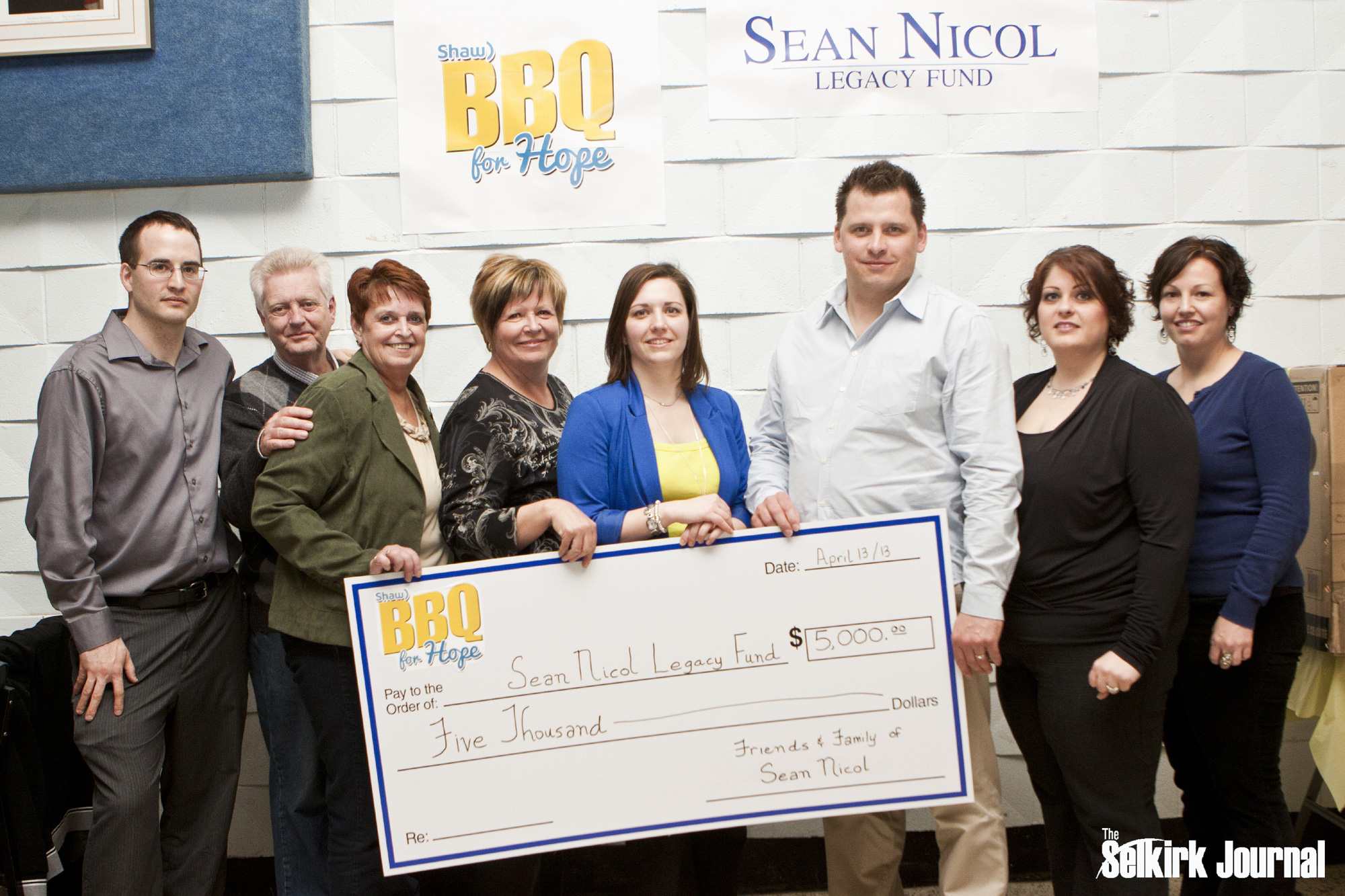 Chris Rey, representing our title sponsor Shaw, joins the SNLF committee to present Selkirk and District Community Foundation representative Lesli Malegus with the BIG cheque. After a final count, over $9,000 was invested into the Sean Nicol Legacy Fund held by the foundation.