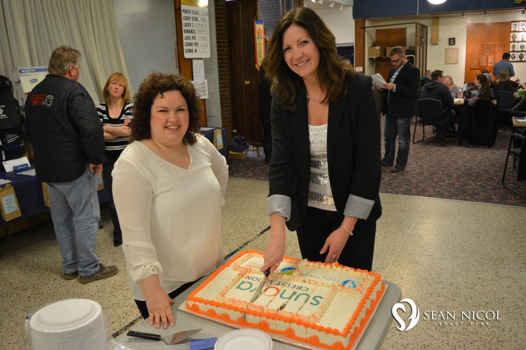 Sunova Credit Union - Dessert Sponsors cutting the cake at the 2016  Shaw BBQ for Hope